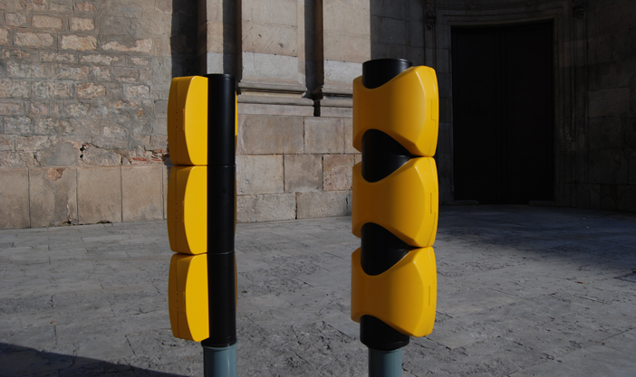 Rear view of Gaudio traffic light, right, and Pla, left.